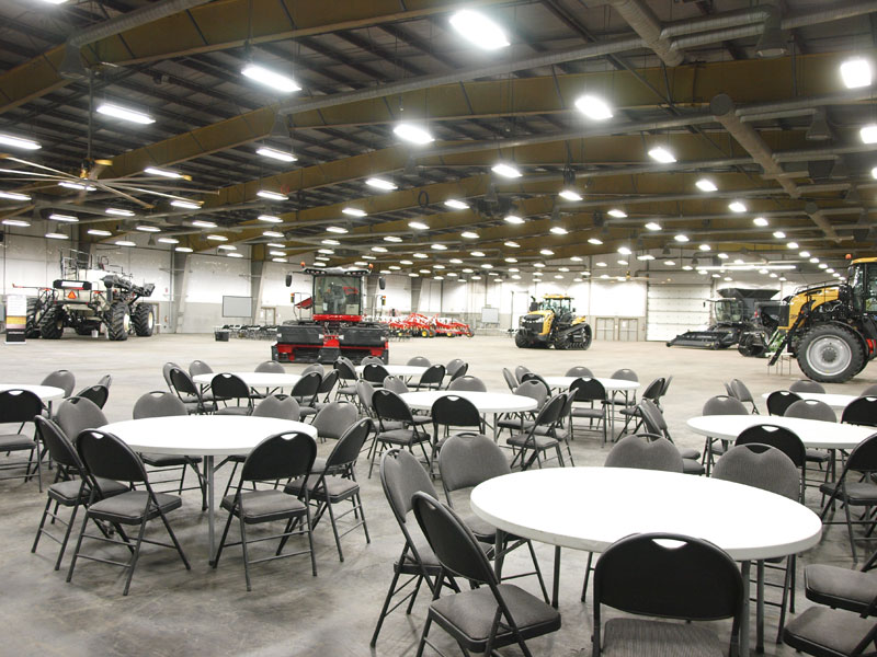 Event Centre tables with large farm equipment on display