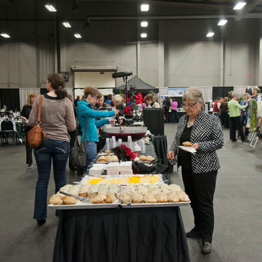 People standing in the Event Centre getting food in line